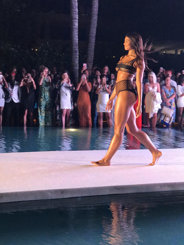 <p><em>SI </em>cover star Danielle Herrington hits the runway in a black mesh bikini for the 2018 <em>Sports Illustrated</em> swimsuit show during Miami Swim Week at the W South Beach hotel on July 15. (Photo: Julie Tong) </p>