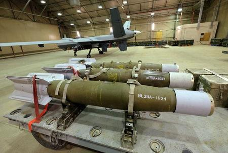 Three 500-pound bombs wait to be loaded on U.S. Air Force drones at Kandahar Airfield, Afghanistan March 9, 2016. To match Exclusive AFGHANISTAN-DRONES/   REUTERS/Josh Smith/File Photo
