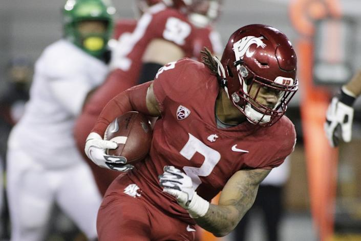 Washington State running back Deon McIntosh (3) carries the ball during the second half.