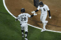 Chicago White Sox's Nick Madrigal, right, celebrates with teammate Leury García (28) after scoring on a fielders choice hit by Nick Williams to defeat the Cleveland Indians 4-3 in the bottom of the ninth inning of a baseball game, Monday, April 12, 2021, in Chicago. (AP Photo/Paul Beaty)