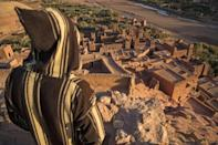 A man overlooks the fortified old city of Ait-Ben-Haddou