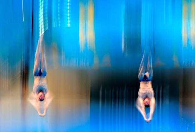 LONDON, ENGLAND - AUGUST 01: Troy Dumais and Kristian Ipsen of the United States compete in the Men's Synchronised 3m Springboard final on Day 5 of the London 2012 Olympic Games at the Aquatics Centre on August 1, 2012 in London, England. (Photo by Adam Pretty/Getty Images)