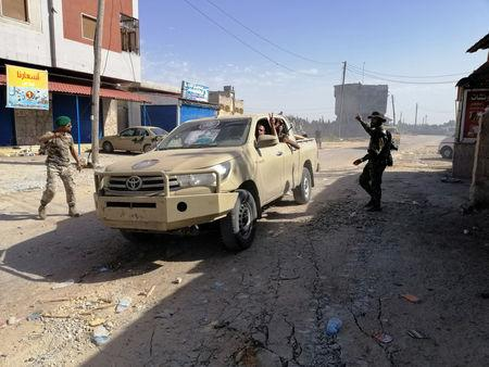 Libyan forces hit two government positions-in push to seize Tripoli