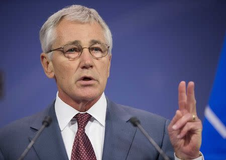 U.S. Defense Secretary Chuck Hagel speaks during a news conference at the end of a meeting of the North Atlantic Council in Brussels