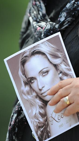 A picture of Reeva Steenkamp, seen on the programme of her funeral ceremony on February 19, 2013, five days after she was shot dead (AFP Photo/Alexander Joe)