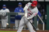 Los Angeles Angels designated hitter Shohei Ohtani hits a solo home run off Kansas City Royals starting pitcher Danny Duffy during the fifth inning of a baseball game at Kauffman Stadium in Kansas City, Mo., Tuesday, April 13, 2021. (AP Photo/Orlin Wagner)