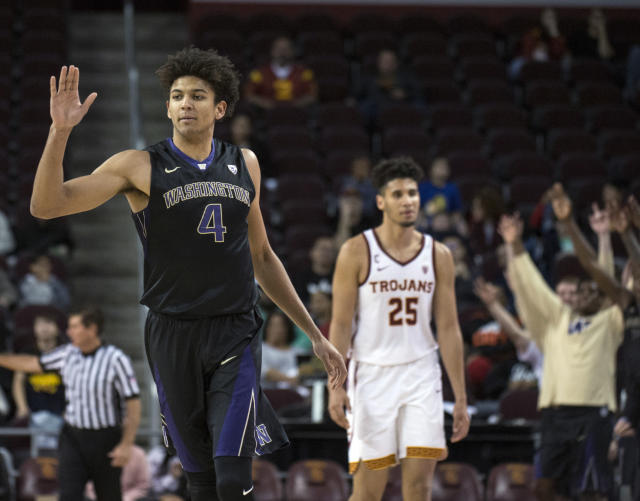 Matisse Thybulle celebrates during Washington's 88-81 win over USC as Trojans forward Bennie Boatwright looks on. (AP)