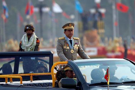 Myanmar's General Min Aung Hlaing  takes part during a parade to mark the 72nd Armed Forces Day in the capital Naypyitaw