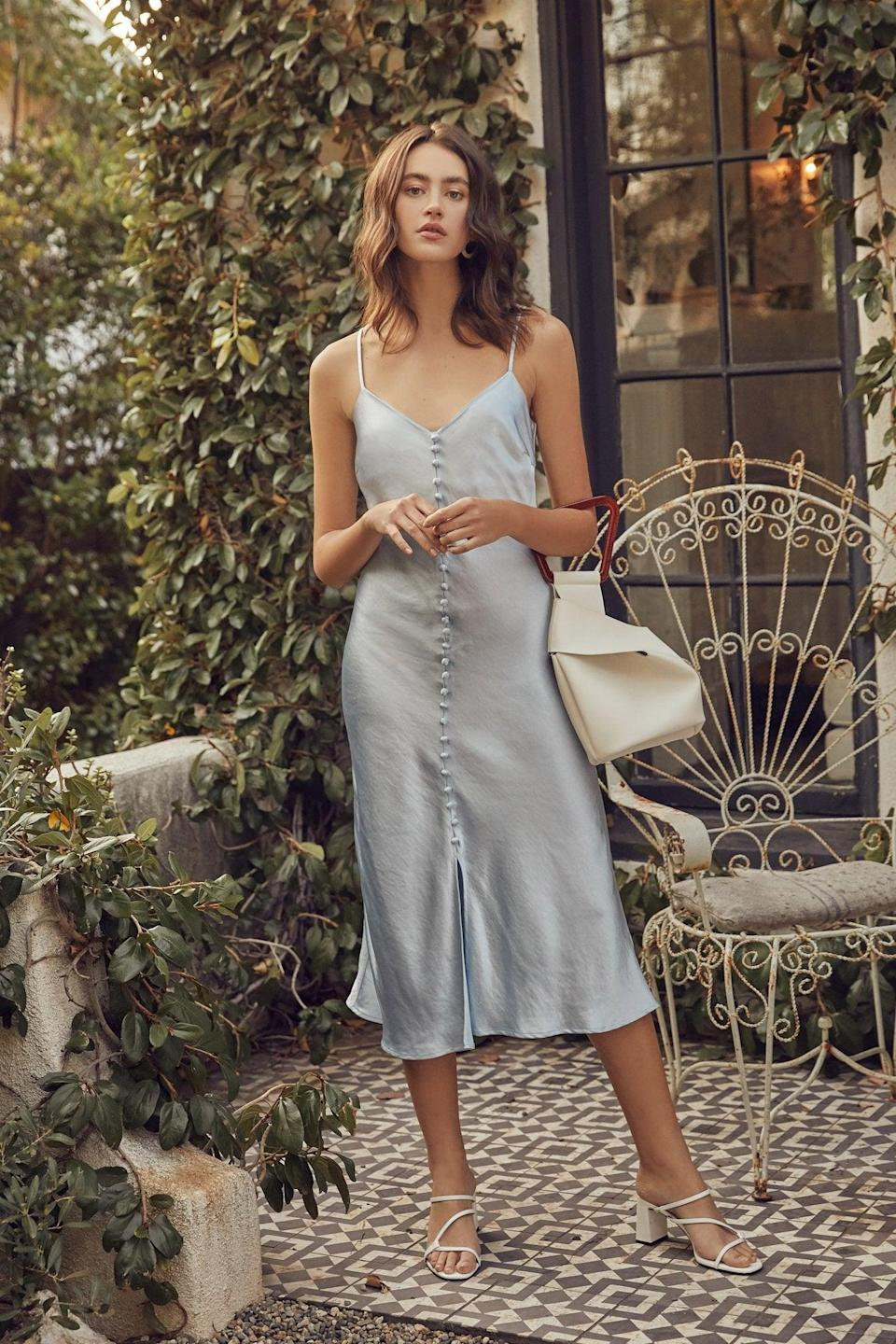 """Get <a href=""""https://www.lucyparis.com/"""" rel=""""nofollow noopener"""" target=""""_blank"""" data-ylk=""""slk:30% off sitewide at Lucy Paris"""" class=""""link rapid-noclick-resp"""">30% off sitewide at Lucy Paris</a> using the checkout code SUMMERREADY. <br> <br> <strong>Lucy Paris</strong> Leonie Slip Dress, $, available at <a href=""""https://go.skimresources.com/?id=30283X879131&url=https%3A%2F%2Fwww.lucyparis.com%2Fcollections%2Fdresses%2Fproducts%2Fleonie-slip-dress-blue"""" rel=""""nofollow noopener"""" target=""""_blank"""" data-ylk=""""slk:Lucy Paris"""" class=""""link rapid-noclick-resp"""">Lucy Paris</a>"""