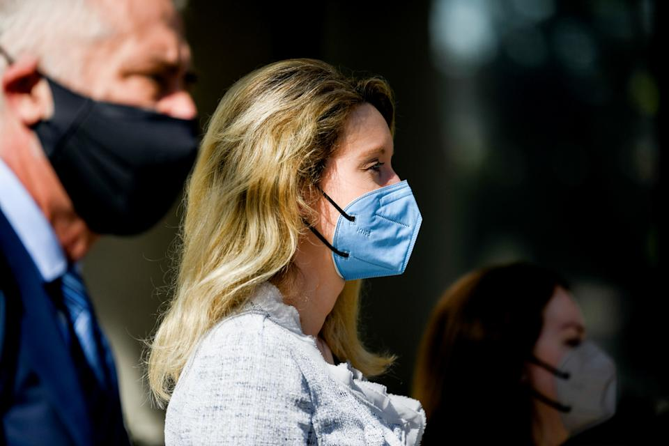 Theranos founder Elizabeth Holmes exits Robert F. Peckham U.S. Courthouse with her attorneys after the first day of federal court hearings, in San Jose, California, U.S. May 4, 2021.  REUTERS/Kate Munsch