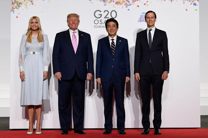 President Donald Trump poses for a photo with Japanese Prime Minister Shinzo Abe and senior advisers Ivanka Trump and Jared Kushner.