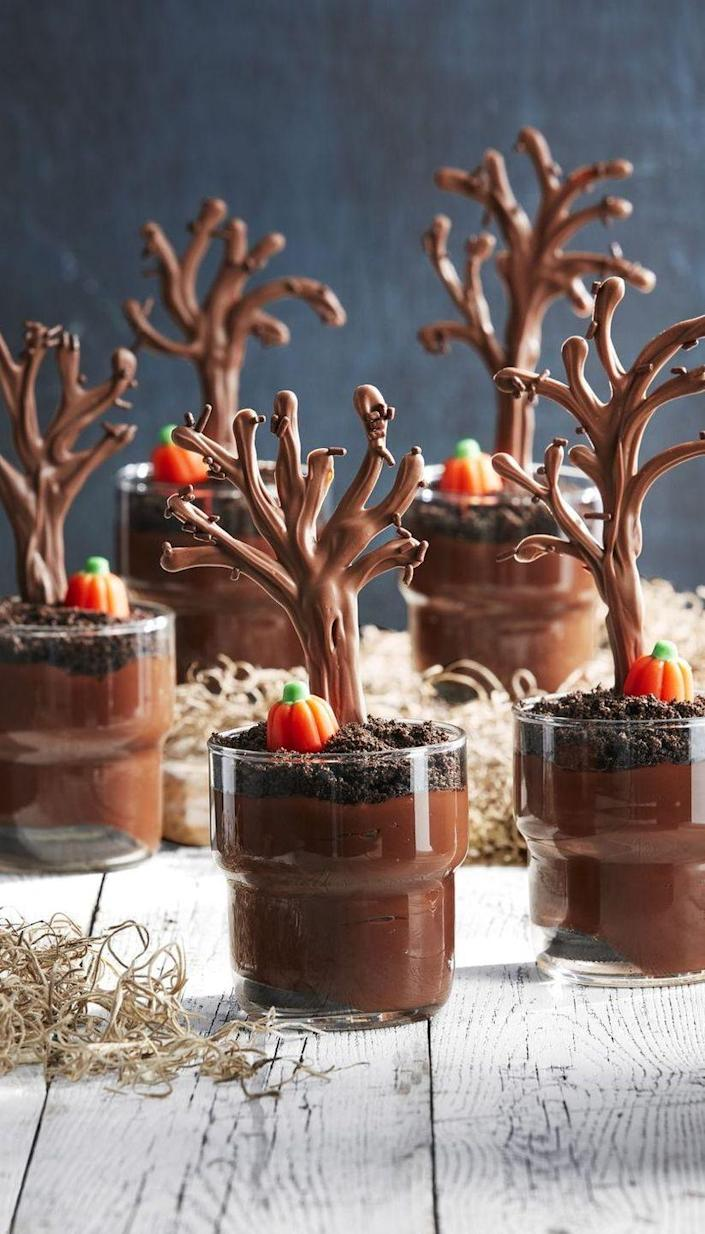 """<p>Place these chocolate pudding cups (topped with crushed chocolate cookies), on any dessert table for a true wow affect. </p><p><strong><em><a href=""""https://www.countryliving.com/food-drinks/a28943384/spooky-forest-pudding-cups/"""" rel=""""nofollow noopener"""" target=""""_blank"""" data-ylk=""""slk:Get the recipe from Country Living."""" class=""""link rapid-noclick-resp"""">Get the recipe from Country Living. </a></em></strong></p>"""