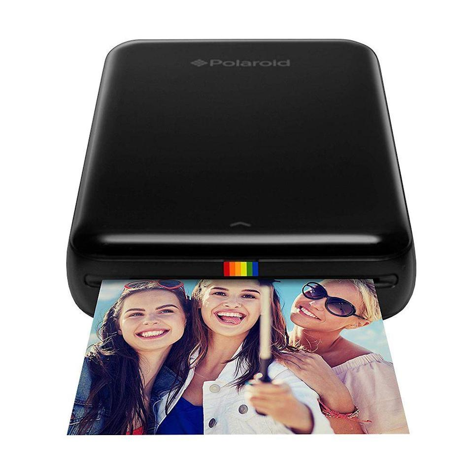 "<p><strong>Polaroid</strong></p><p>amazon.com</p><p><strong>$194.99</strong></p><p><a href=""https://www.amazon.com/dp/B00XM0XZ5M?tag=syn-yahoo-20&ascsubtag=%5Bartid%7C2089.g.2149%5Bsrc%7Cyahoo-us"" rel=""nofollow noopener"" target=""_blank"" data-ylk=""slk:Shop Now"" class=""link rapid-noclick-resp"">Shop Now</a></p><p>Gone are the days when you'd regularly go to the store to get film developed, but that doesn't mean you can't print out your favorite pictures. This Polaroid mobile printer connects via Bluetooth so you can print as quickly as you take the photos!</p>"