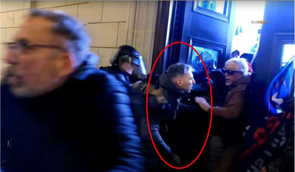 Marine Corps Major Christopher Warnagiris, seen here allegedly helping rioters breach the Capitol building on Jan. 6, 2021, now faces multiple federal charges for his role in the insurrection. (Photo: FBI)