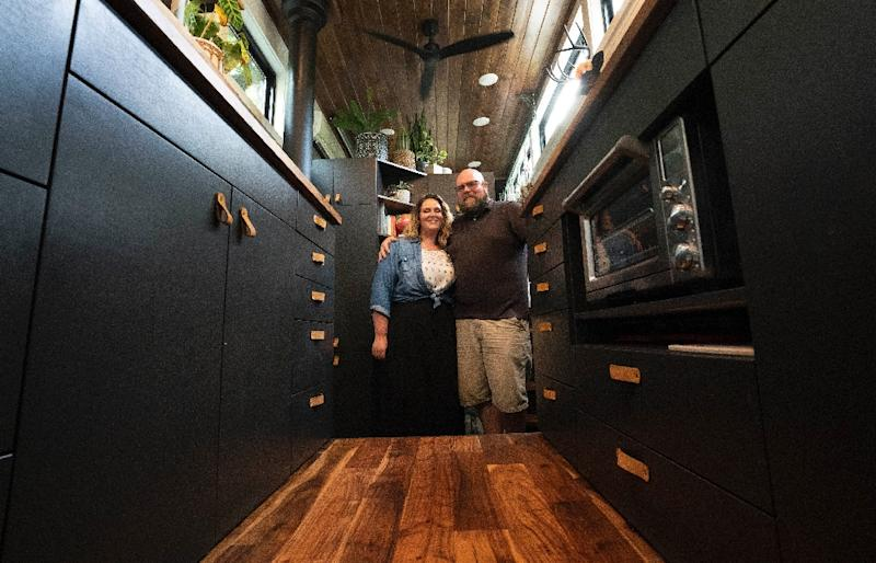 Scott Berrier and his wife Melissa -- seen inside their tiny home in Elizabethtown, Pennsylvania -- say they are happy with a more minimalist approach to life (AFP Photo/Don Emmert)