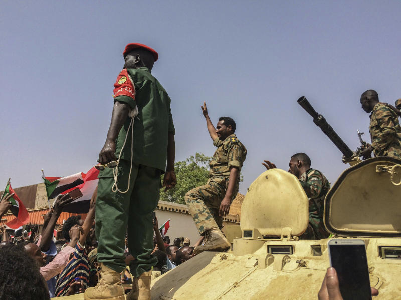 Sudanese forces celebrate after officials said the military had forced longtime autocratic President Omar al-Bashir to step down after 30 years in power in Khartoum, Sudan, Thursday, April 11, 2019. (AP Photo)