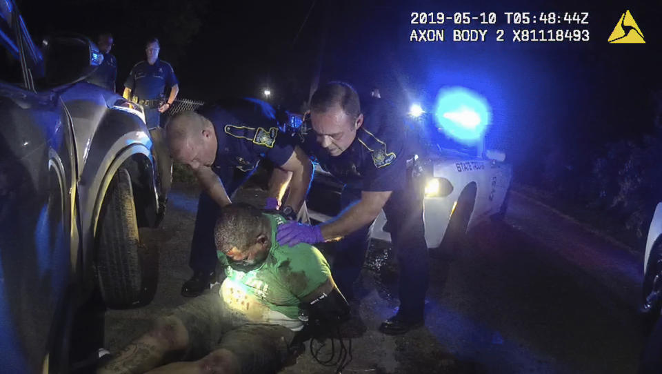FILE - In this May 10, 2019 image from Louisiana State Trooper Dakota DeMoss' body camera, troopers hold Ronald Greene before paramedics arrived outside of Monroe, La. The video shows Louisiana state troopers stunning, punching and dragging Greene as he apologizes for leading them on a high-speed chase. (Louisiana State Police via AP)