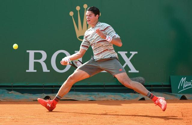 Injured: Canada's Milos Raonic has pulled out of the French Open (AFP Photo/YANN COATSALIOU)