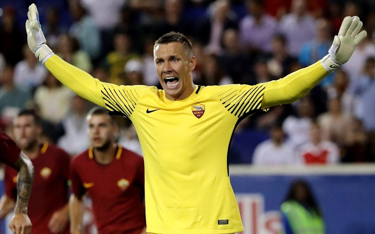 Crystal Palace are pursuing a deal for Roma goalkeeper Lukasz Skorupski, after manager Frank de Boer prioritised the addition of a new goalkeeper to his squad by the end of this month. De Boer wants to increase competition across the Eagles squad and has earmarked the goalkeeping position as an area that requires further attention. Palace are currently limited in that respect. The sale of Steve Mandanda to Marseille earlier this summer has left them with just two recognised senior goalkeepers - Welshman Wayne Hennessey, who featured in their calamitous opening day defeat to Huddersfield and 38-year-old veteran Julian Speroni. With neither player convincing de Boer of their long-term credentials to become his number one choice, a shortfall of options led Palace into a failed attempt to prise Adrian away from West Ham United with a £3.5million offer last week. Palace had hoped to be able to capitalise on the Spaniard's demotion to become Joe Hart's understudy at the London Stadium but have now moved on to other targets with Skorupski and PSV Eindhoven goalkeeper Jeroen Zoet both on their radar. Frank de Boer suffered a chastening 3-0 home defeat in his first game as Crystal Palace manager Credit: PA Skorupski, who has one senior cap for Poland would cost Palace in the region of £6-8 million depending on add-ons. However, Palace favour a deal that would allow them to take the player on-loan for the season with the option to buy at a predetermined price next summer. The 26-year-old has spent the last two seasons on-loan at fellow Serie A outfit Empoli, after signing for Roma in 2013. Zoet, who is the same age as Skorupski and is also interesting Benfica, has been capped nine times by the Netherlands. Pick your free Telegraph Fantasy Football team now and start scoring from the next kick-off >>
