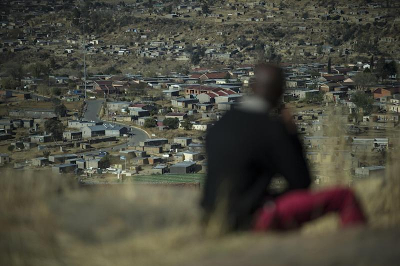 A man sits on a hill overlooking Maseru, on August 31, 2014