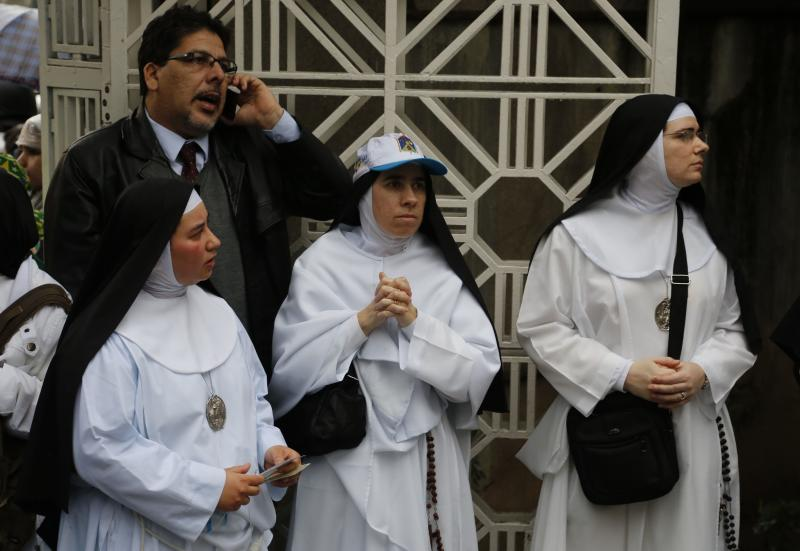 Nuns wait for the arrival of Pope Francis at the entrance of St. Francis of Assisi of the Providence of God Hospital, where the Franciscans look after alcohol and drug addicts, in Rio de Janeiro, Brazil, Wednesday, July 24, 2013. (AP Photo/Jorge Saenz)
