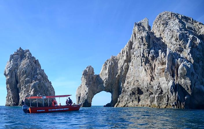 BAJA CALIFORNIA SUR, MEXICO - Water taxi approaches El Arco, Cabo San Lucas, 2015. (Christopher Reynolds/Los Angeles Times)