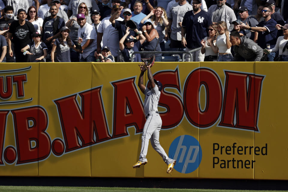 Tampa Bay Rays left fielder Randy Arozarena makes a catch on a fly out by New York Yankees' Aaron Judge during the third inning of a baseball game on Saturday, Oct. 2, 2021, in New York. (AP Photo/Adam Hunger)