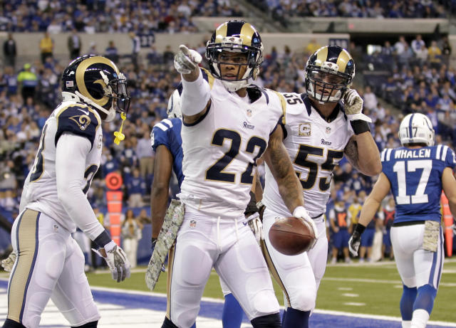 St. Louis Rams cornerback Trumaine Johnson, center, celebrates an interception with teammates James Laurinaitis (55) and free safety Rodney McLeod during the second half of an NFL football game against the Indianapolis Colts in Indianapolis, Sunday, Nov. 10, 2013. (AP Photo/AJ Mast)