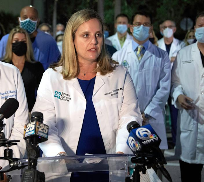 Dr. Jennifer Buczyner of Jupiter Medical Center speaks as a group of physicians and administrators gathered in Palm Beach Gardens early Monday morning, August 23, 2021 to support vaccinations and the wearing of masks in their fight against COVID-19.  The entire physician staff of Palm Beach Gardens Medical Center was invited, as well as doctors from other area hospitals.