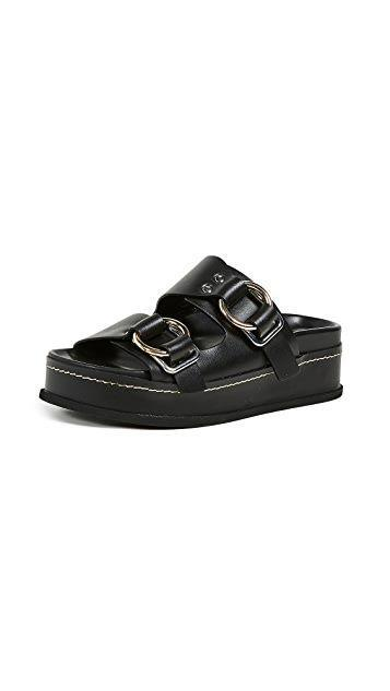 """<p><strong>3.1 Phillip Lim</strong></p><p>Shopbop.com</p><p><strong>$250.00</strong></p><p><a href=""""https://click.linksynergy.com/deeplink?id=6Km1lFswsiY&mid=42352&murl=https%3A%2F%2Fwww.shopbop.com%2Ffreida-platform-buckle-slide-31%2Fvp%2Fv%3D1%2F1579899453.htm"""" rel=""""nofollow noopener"""" target=""""_blank"""" data-ylk=""""slk:Shop Now"""" class=""""link rapid-noclick-resp"""">Shop Now</a></p><p>Step up the classic style with the addition of an extra buckle or unique touch here and there. An extra lift comes with the added height, and we love the curved detailing. This pair transitions perfectly into fall with the addition of your favorite socks. </p>"""