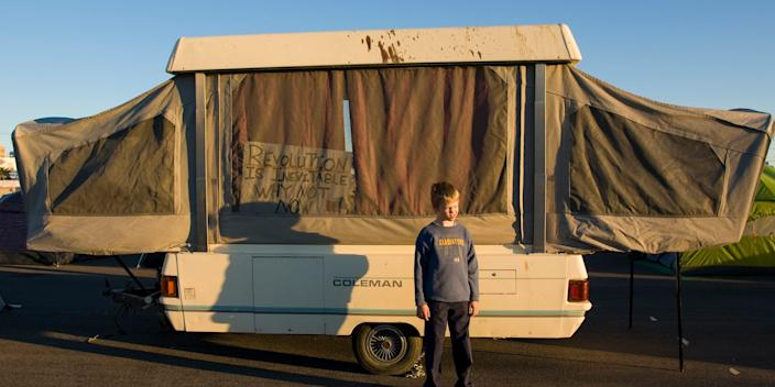 A boy next to his family's pop-up trailer at the Occupy Las Vegas camp on October 23, 2011.
