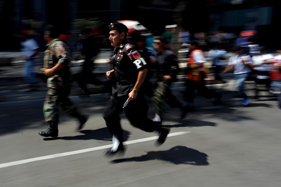 Members of the Mexican rescue team running