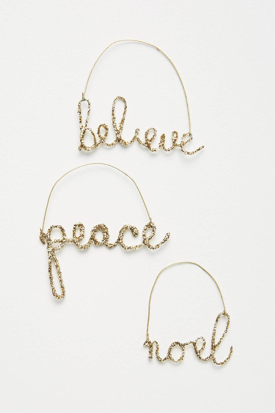 """<p>Send peaceful wishes into the world with the <a href=""""https://www.popsugar.com/buy/Festive-Wire-Word-Ornaments-Set-Three-490501?p_name=Festive%20Wire%20Word%20Ornaments%2C%20Set%20of%20Three&retailer=anthropologie.com&pid=490501&price=14&evar1=casa%3Aus&evar9=46615300&evar98=https%3A%2F%2Fwww.popsugar.com%2Fhome%2Fphoto-gallery%2F46615300%2Fimage%2F46615371%2FFestive-Wire-Word-Ornaments-Set-Three&list1=shopping%2Canthropologie%2Choliday%2Cchristmas%2Cchristmas%20decorations%2Choliday%20decor%2Chome%20shopping&prop13=mobile&pdata=1"""" rel=""""nofollow noopener"""" class=""""link rapid-noclick-resp"""" target=""""_blank"""" data-ylk=""""slk:Festive Wire Word Ornaments, Set of Three"""">Festive Wire Word Ornaments, Set of Three</a> ($14).</p>"""