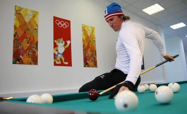 Austrian alpine skier Max Franz plays billiard in the game room at the Olympic athletes mountain village in Rosa Khutor near Sochi, February 4, 2014. Sochi will host the 2014 Winter Olympic Games from February 7 to 23. REUTERS/Kai Pfaffenbach (RUSSIA - Tags: SPORT SKIING OLYMPICS)