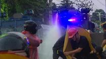 Thai protesters defiant after police use water cannon, tear gas on demonstration