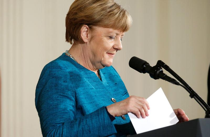 German Chancellor Angela Merkel sorts her notes during a joint news conference with U.S. President Donald Trump in the East Room of the White House in Washington