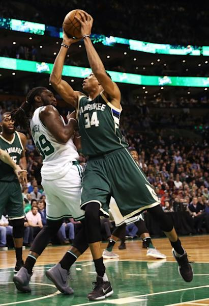 Giannis Antetokounmpo of the Milwaukee Bucks takes a shot against Jae Crowder of the Boston Celtics during the first quarter, at TD Garden in Boston, Massachusetts, on March 29, 2017