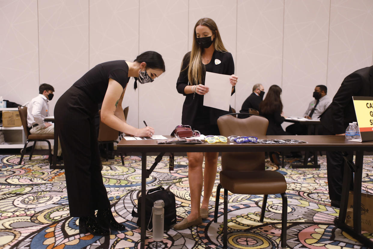 TAMPA, FL - MAY 25: Seminole Hard Rock Casino department supervisor Carol Anne Haslam (R) speaks with Grace Dudley, a job applicant, during a job fair at the Seminole Hard Rock Casino on May 25, 2021 in Tampa, Florida. The Florida Department of Economic Opportunity announced that the state government will stop paying the $300-a-week federal benefit urging residents to return to the workforce. (Photo by Octavio Jones/Getty Images)