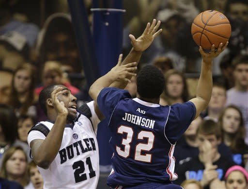 Butler forward Roosevelt Jones, left, goes up to block the shot of Duquesne guard Sean Johnson during the second half of an NCAA college basketball game in Indianapolis, Tuesday, Feb. 19, 2013. Butler defeated Duquesne 68-49. (AP Photo/Michael Conroy)
