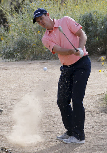 Justin Rose, of England, hits from the desert on the 15th hole in his match against Scott Piercy during the first round of the Match Play Championship golf tournament on Wednesday, Feb. 19, 2014, in Marana, Ariz. (AP Photo/Matt York)