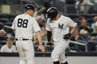 New York Yankees third base coach Phil Nevin, left, celebrates with Gary Sanchez, right, as Sanchez runs the bases after hitting a home run during the second inning of a baseball game against the Texas Rangers, Monday, Sept. 20, 2021, in New York. (AP Photo/Frank Franklin II)