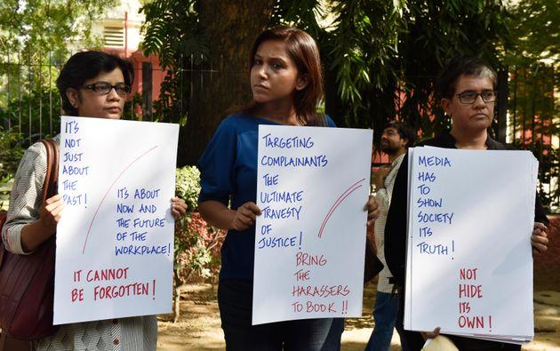 NEW DELHI, INDIA - OCTOBER 13: Electronic and Print media journalists stand to protest against the sexual harassment at the workplaces as part of the #MeToo campaign at Parliament Street, on October 13, 2018 in New Delhi, India. The protesting journalists also sought immediate action against those facing allegations of sexual misconduct. (Photo by Mohd Zakir/Hindustan Times via Getty Images)