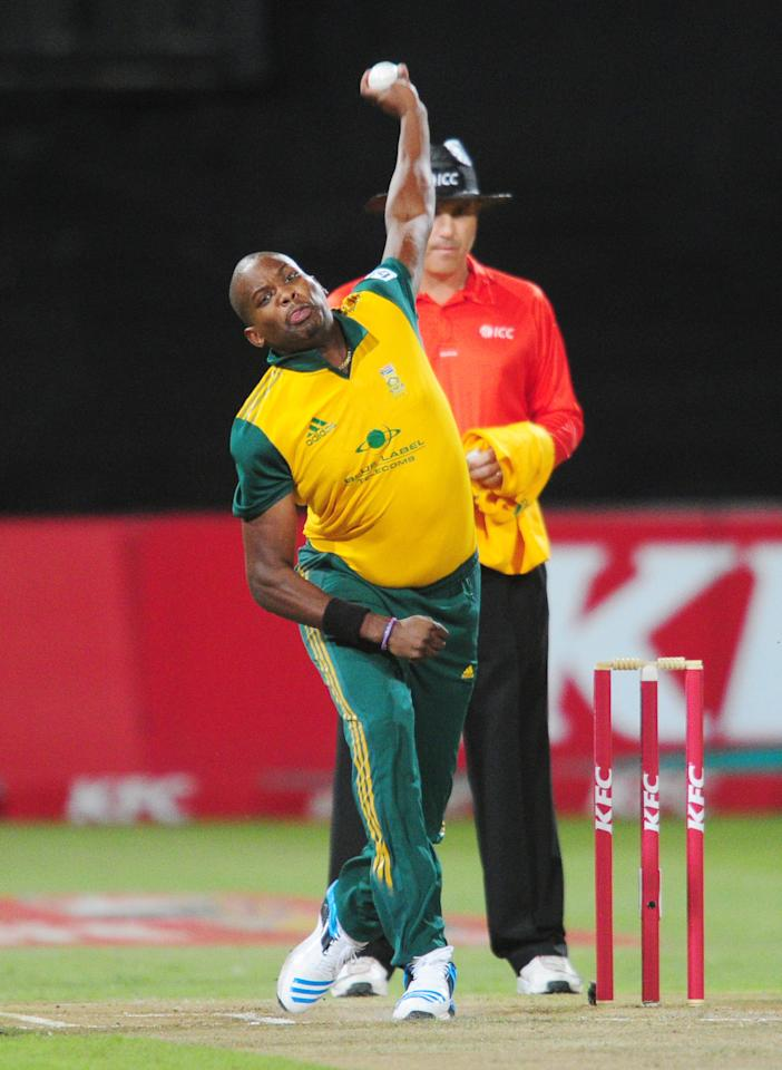 In this photo taken Wednesday, March 12, 2014, South Africa's Lonwabo Tsotsobe delivers a ball during their rain-delayed T20 cricket match against Australia in Durban, South Africa. (AP Photo)