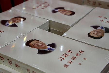 "FILE PHOTO: Copies of book ""Xi Jinping: The governance of China"" are displayed for sale at a bookstore in Beijing"
