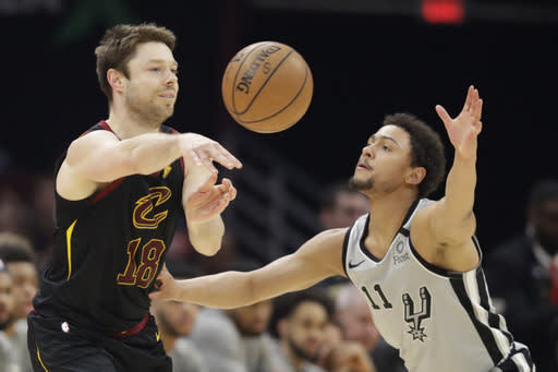 FILE - In this March 8, 2020, file photo, Cleveland Cavaliers' Matthew Dellavedova (18) passes against San Antonio Spurs' Bryn Forbes (11) in the second half of an NBA basketball game in Cleveland. The Cavaliers are nearing a deal with free agent guard Dellavedova, one of the Cavs' most popular players. (AP Photo/Tony Dejak, File)