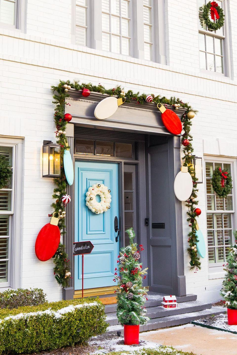 "<p>It's impossible to resist the spirit of the holiday with this bold outdoor Christmas design—complete with oversized wooden ornaments and quirky potted trees—by <a href=""https://sugarandcloth.com/"" rel=""nofollow noopener"" target=""_blank"" data-ylk=""slk:Sugar & Cloth"" class=""link rapid-noclick-resp"">Sugar & Cloth</a>.</p>"