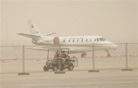 An aircraft is pictured during a sandstorm at the Dubai Airshow