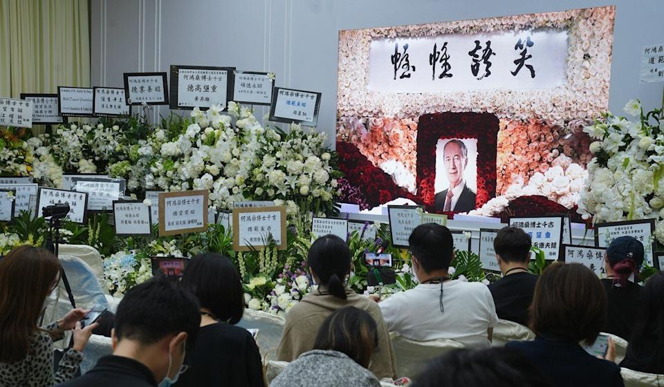 Members of the press watch a live stream of the funeral service of gambling magnate Stanley Ho at the Hong Kong Funeral Home in North Point in July. Photo: Sam Tsang