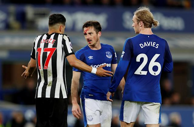 "Soccer Football - Premier League - Everton v Newcastle United - Goodison Park, Liverpool, Britain - April 23, 2018 Everton's Leighton Baines speaks Newcastle United's Ayoze Perez after sustaining an injury as Everton's Tom Davies looks on Action Images via Reuters/Lee Smith EDITORIAL USE ONLY. No use with unauthorized audio, video, data, fixture lists, club/league logos or ""live"" services. Online in-match use limited to 75 images, no video emulation. No use in betting, games or single club/league/player publications. Please contact your account representative for further details."