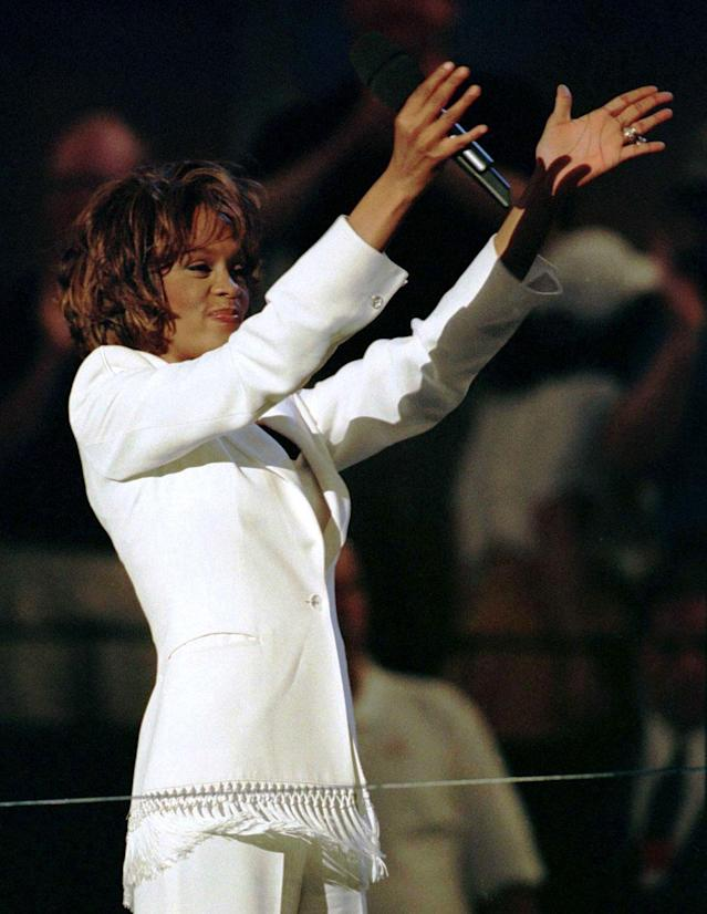Singer Whitney Houston performs during a tribute to Arthur Ashe at the formal dedication of the new Arthur Ashe Stadium at the U.S. Open in New York, August 25. The tribute included over 40 past champions of the U.S. Open.